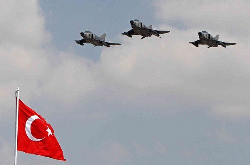 ** file ** turkish air force fighters fly over a national flag during a ceremony on the victory day in ankara, turkey, in this aug. 30, 2007 file photo. turkish warplanes hit kurdish rebel targets in northern iraq early sunday, dec. 16, 2007, turkey's military said, the first such attack since the u.s.-led invasion of iraq. (ap photo/burhan ozbilici, file)