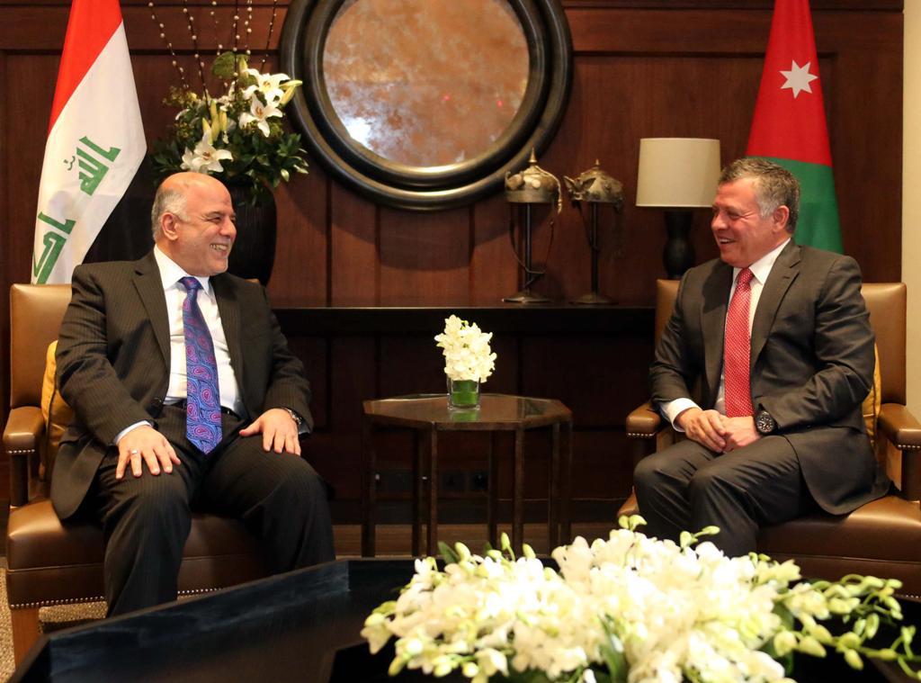 العبادي والملك الأردني يؤكدان على ضرورة تأمين الطريق الدولي بين بغداد وعمان