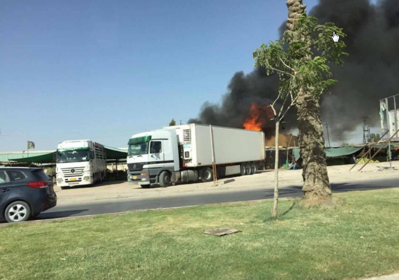 حريق كبير في حي رمضان على الطريق السريع في محافظة كربلاء (15/تموز/2016)