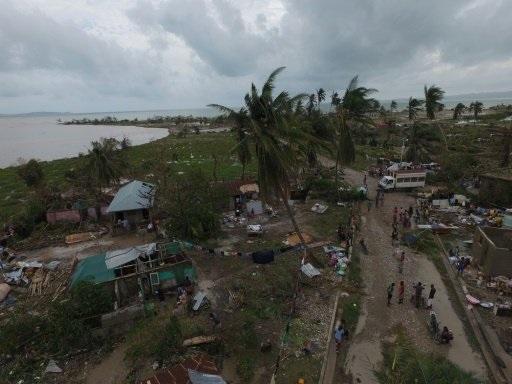 """بالصور .. ما خلفه إعصار """"ماثيو"""" من دمار"""