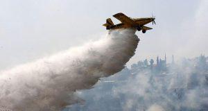 اندلعت الحرائق في إسرائيل من شمالها إلى جنوبها (Photo credit should read AHMAD GHARABLI/AFP/Getty Images)