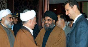 بشار الاسد ورفسنجاني، ويظهر حسن نصر الله في الوسط - ارشيفية