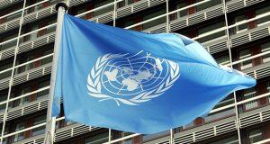 """علم الأمم المتحدة أمام """"مجمع الامم المتحدة"""" - المانيا ، (AP Photo/Hermann J. Knippertz)"""