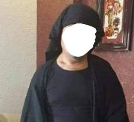 اعتقال رجل يتنكر بزي النساء بين الزائرين في النجف