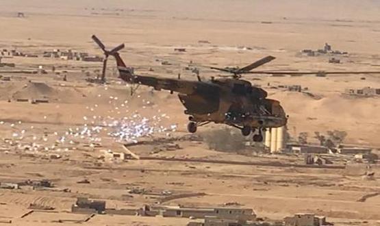 طيران الجيش يلقي منشورات للمواطنين في مناطق أعالي الفرات بالانبار