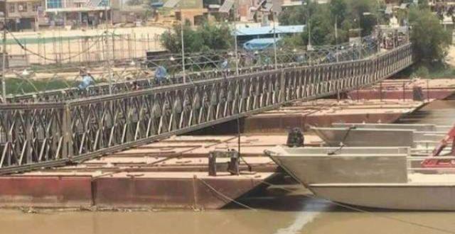 بالصور.. إعادة ربط جسر الكريعات بعد انخفاض نسبي لدجلة