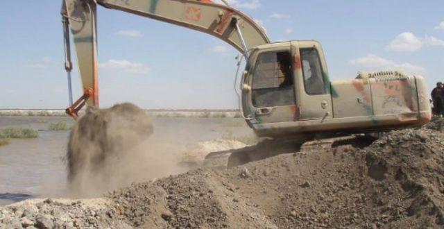 تحصين السدة الترابية بين العراق وإيران استعداداً للفيضانات