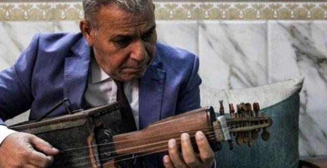 """عازف عراقي يحول """"سلاحه الشخصي"""" الى آله موسيقية"""