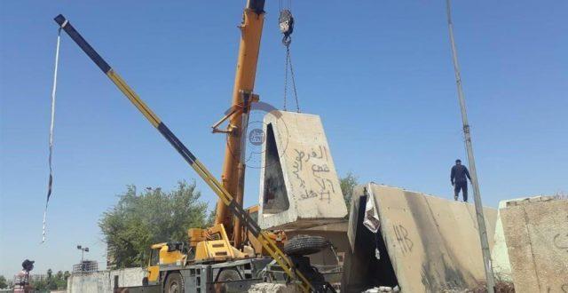 بالصور.. رفع الكتل الكونكريتية من جسر السنك ومحيطه بعد استحصال الموافقات