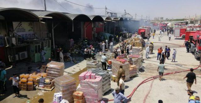 بالصور:الدفاع المدني يتمكن من اخماد حريق اندلع في مخازن للمواد الغذايئة في النجف