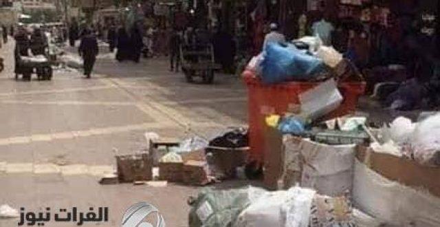 بالصور. شوارع النجف تمتلئ بالنفايات بعد اضراب عمال النظافة