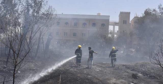 بالصور..فرق الاطفاء تسيطر على حريق اندلع في جامعة واسط